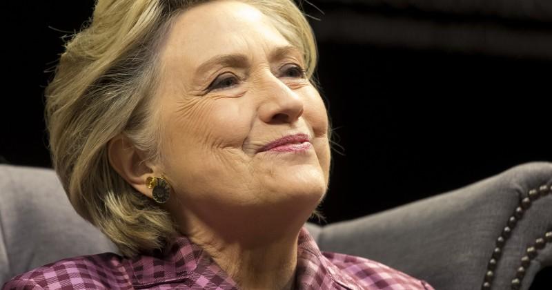 Hillary Clinton Laughs & Jokes at Arrest of Julian Assange