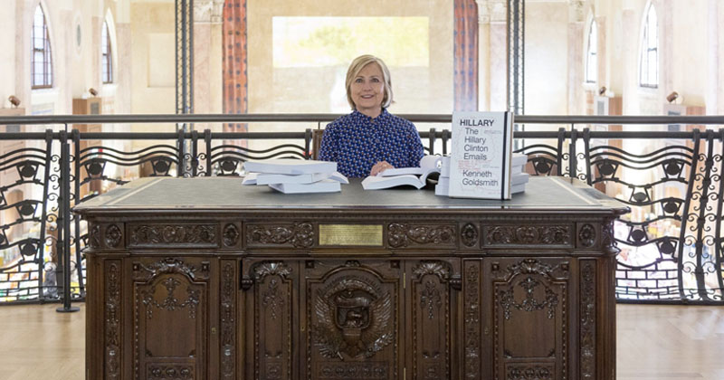 Hillary Clinton Reads Emails While Pretending To Be President At Art Exhibit
